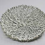Filaments porcelaine blanche sur filaments porcelaine noire